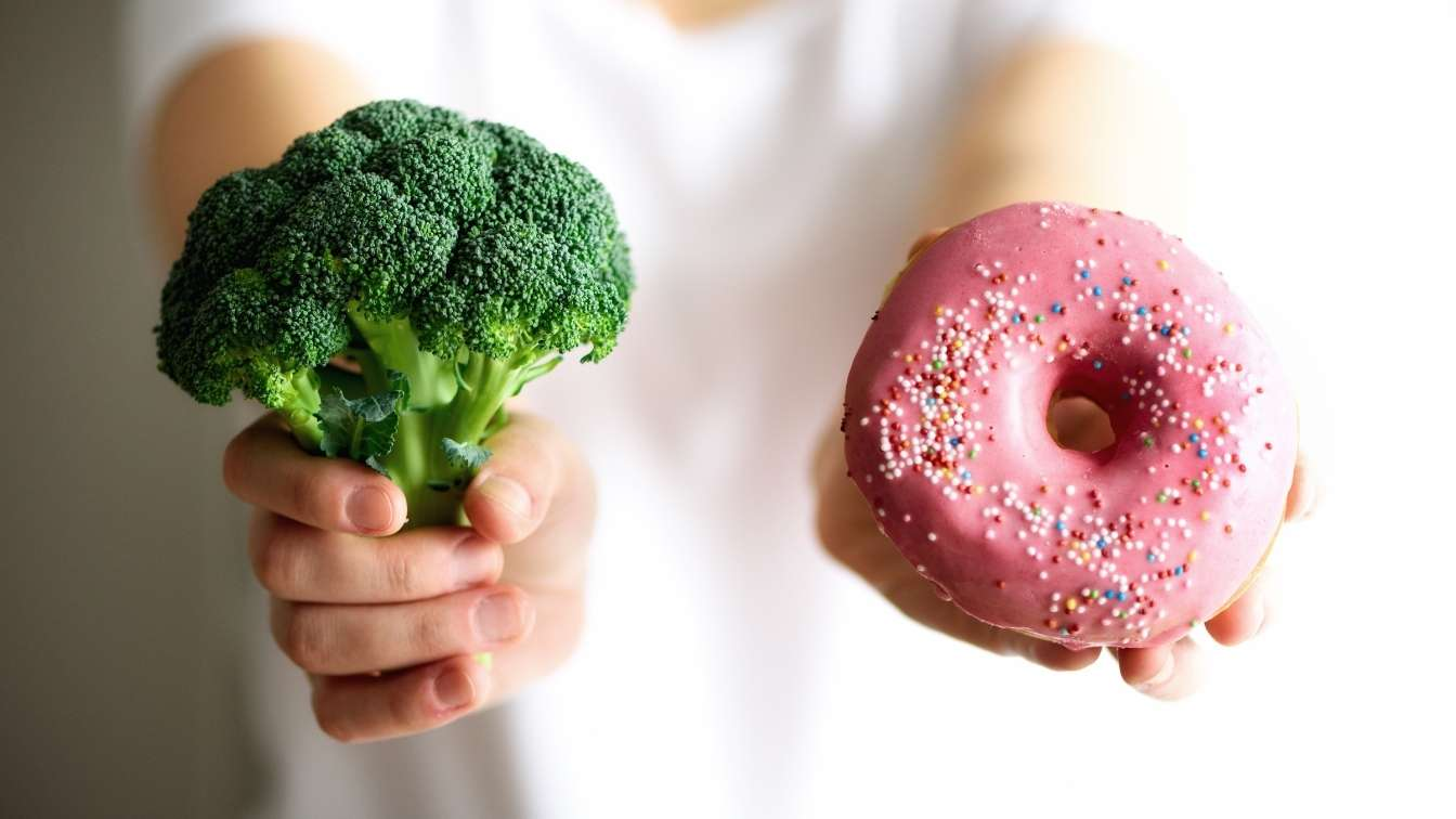 Brocolli in one hand, doughnut in the other. Which will you choose?