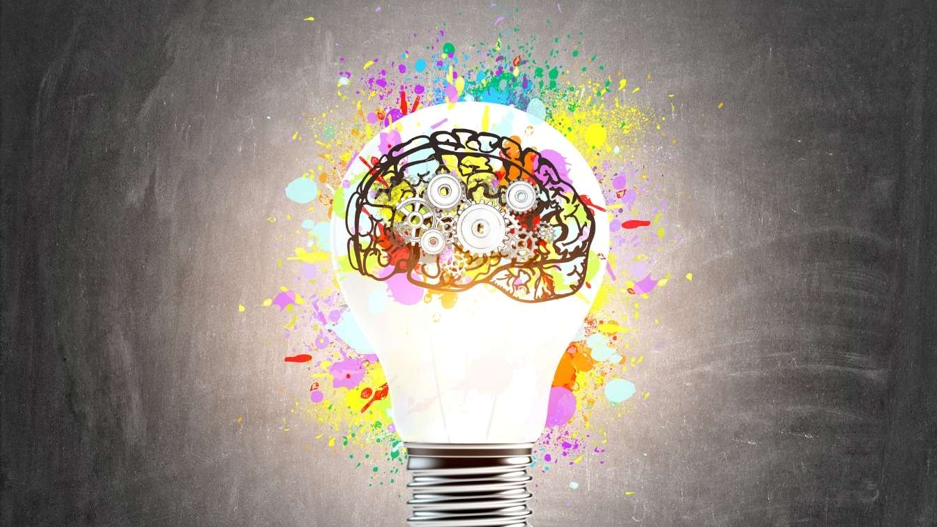 Brain inside lighbulb indicating understanding